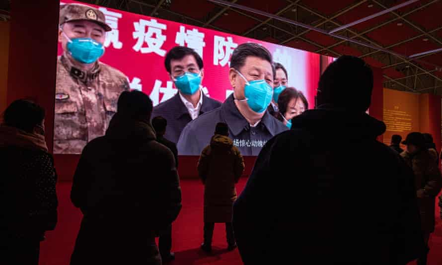 A screen showing Xi Jinping during the government-sanctioned exhibition called 'People First, Lives First'