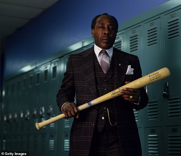 Clark said that the baseball bat he was often seen holding was not a weapon but a symbol of choice: a student could either strike out or hit a home run. Pictured above in 1988