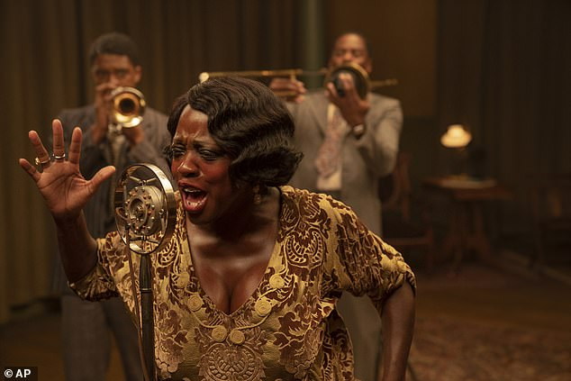 Viola Davis (flanked by Boseman and Domingo) stars as blues icon Ma Rainey in the musical drama, which is based off August Wilson's play