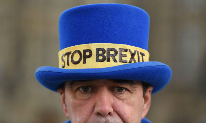An anti-Brexit campaigner outside the Houses of Parliament in London on December 11, 2018.