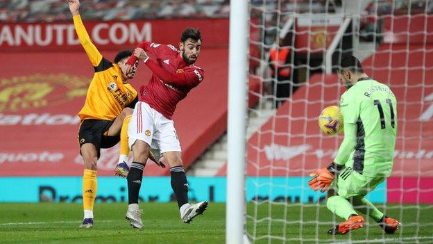 Bruno Fernandes sees his shot saved by Wolves keeper Rui Patricio