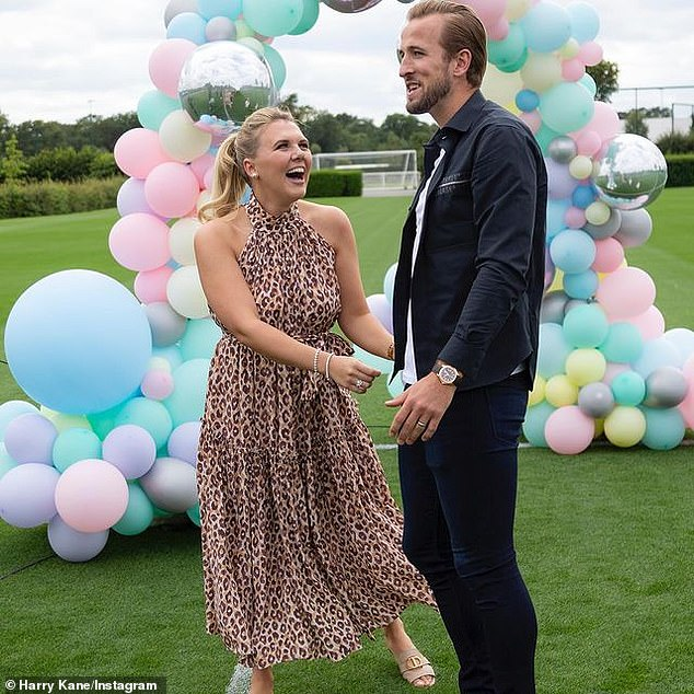 Adorable: Together, the married couple proudly showed off their newborn and footballer Harry said he 'couldn't be more proud' of his wife following the labour