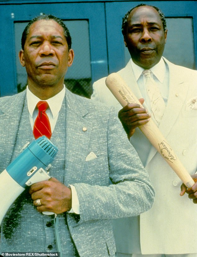 Biographical drama: The baseball bat and bullhorn-wielding principal inspired the 1989 film Lean On Me starring Morgan Freeman. Freeman and Clark pictured together above