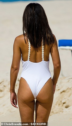 Sizzling: She showed off her derriere and her lithe legs