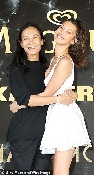 Wang pictured with model Bella Hadid in 2018