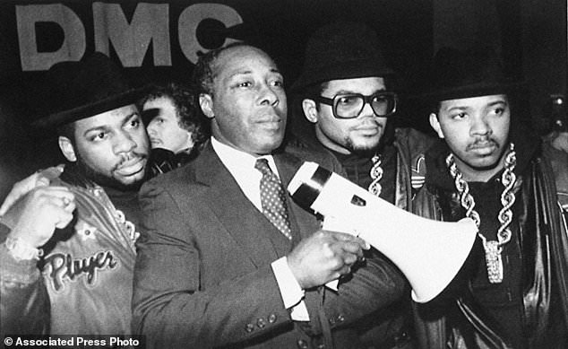Strong support: Clark, as principal of Eastside High School in Paterson, N.J., stands with rap group Run-DMC before the group gave a concert at the school in February 1988 in support of Clark's way of running his school