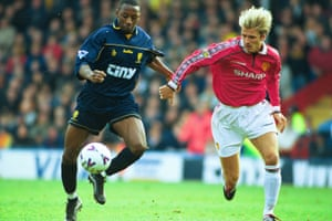 Jason Euell battles with David Beckham during a Wimbledon game against Manchester United in 2000.