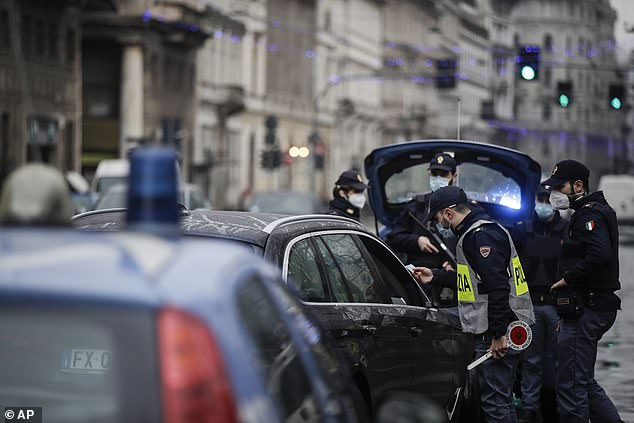 People have been banned from travelling long-distance in Italy to reunite with their families over Christmas, with police enforcing the rules in Milan on Thursday