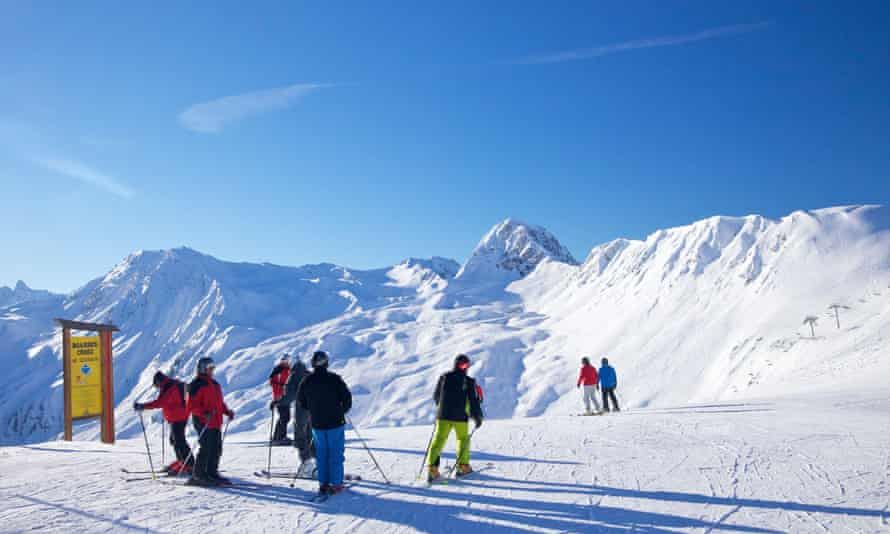 A group of skiers high up in the French Alps