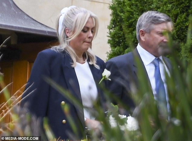 Pretty:In her hands she carried a stunning bouquet of white flowers, matching perfectly with her ribbon and Richard's flower in his lapel