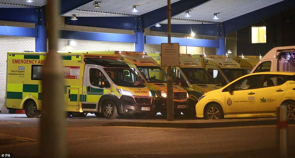Ambulances outside Queen's Hospital in Romford, London, tonight, which has moved into the highest tier of coronavirus restrictions as a result of soaring case rates