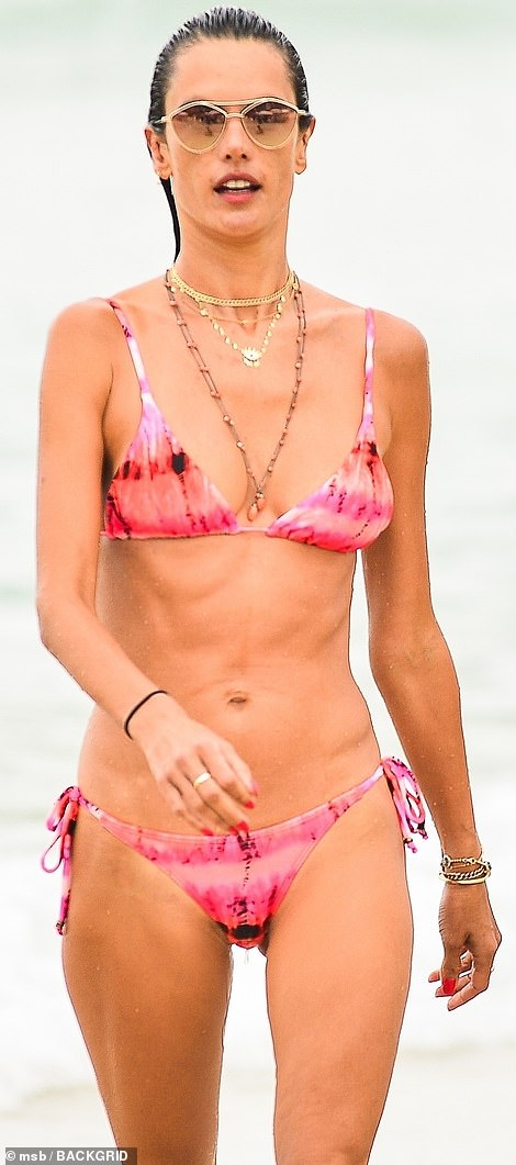 Natural wonder: The former Victoria's Secret Angel was all smiles as she ventured into the ocean, making it about waist high before refreshing herself with a dunk under the surface