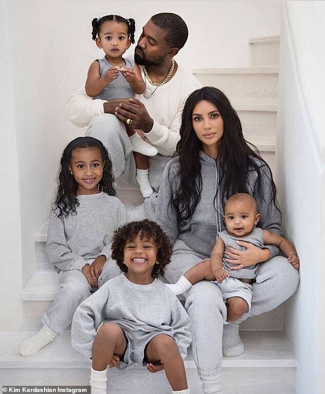 MIA:Missing from the action on Thursday was Kim's husband Kanye, amid reports that the couple are spending time apart; Kim, Kanye, and their children pictured in 2019