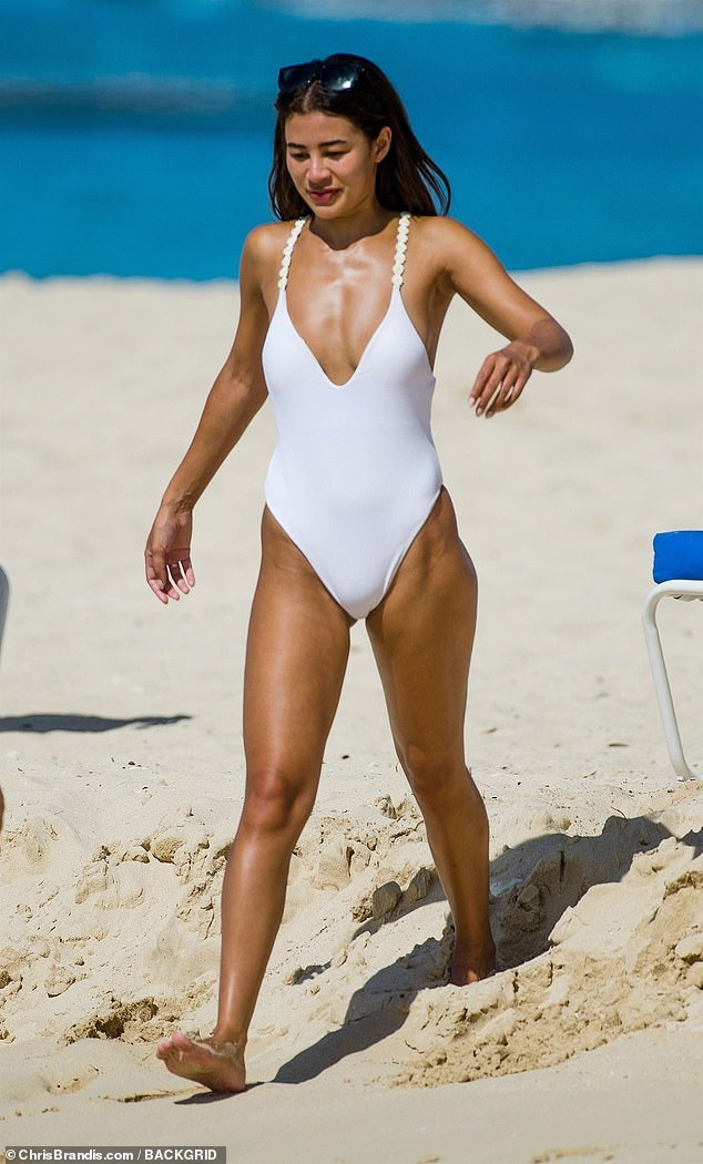 Sandy: She strutted along the beach, treating the sand as her very own catwalk