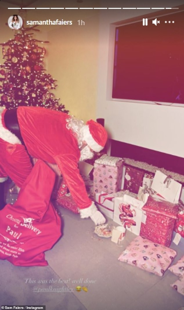 Ho Ho Ho: Sam also shared a snap of Paul, 32, dressed as Santa Claus as he delivered presents for the couple's children Paul, five and three-year-old Rosie