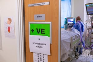 A Covid-positive sign on a door inside intensive care