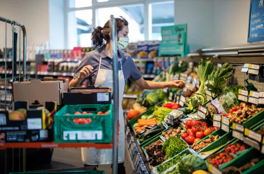 The supermarket staff … who risked their wellbeing to keep us fed. (Posed by a model.)