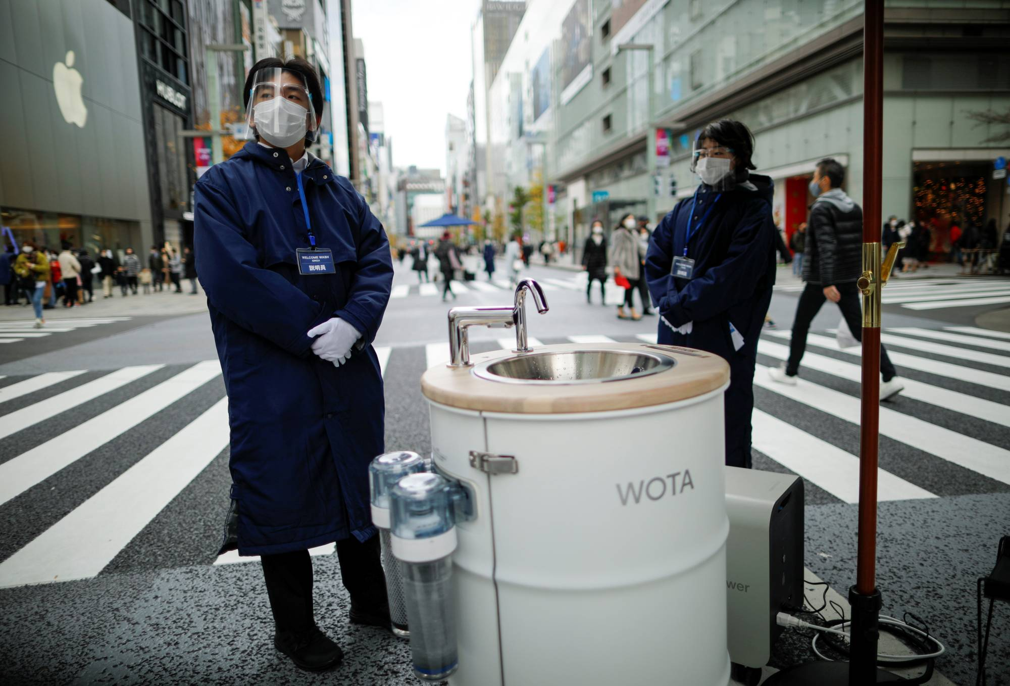Innovative measures have been implemented across East Asia in a bid to beat the pandemic, with Tokyo's Ginza shopping district recently hosting a series of hand-washing and phone sanitizing stations. | REUTERS