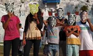 Young protesters wearing masks