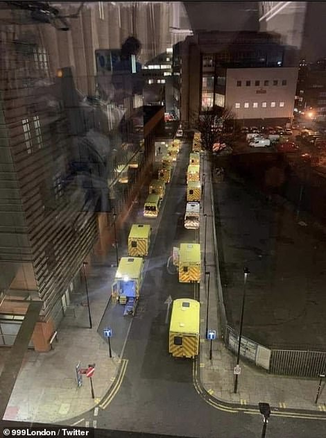 A photo of London Royal Hospital this evening, showing a queue of ambulances parked up outside