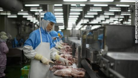 In this photo, taken on August 28, 2018, cuts of meat are processed at a Spam factory in Jincheon, South Korea.