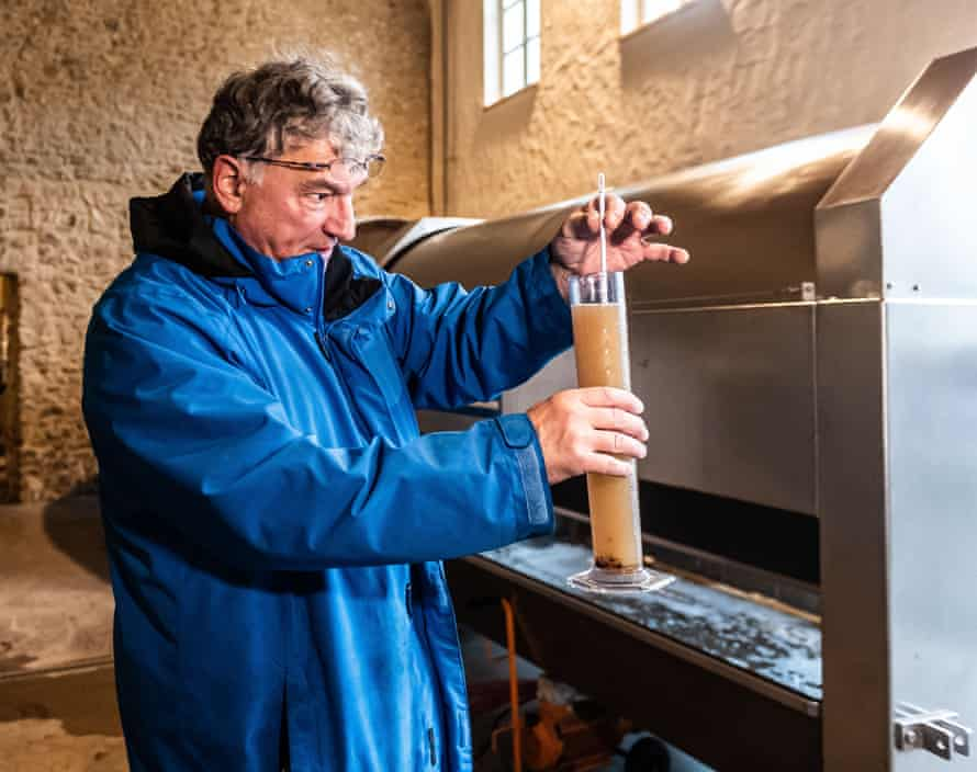 Vintner Ralf Petgen measures the Oechsle or sugar content of his eiswein.