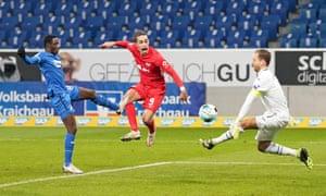 Yussuf Poulsen scores the winner for Leipzig at Hoffenheim.