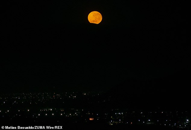 The moon will be in the sky for more than 15 hours from Tuesday evening into Wednesday morning, making it the longest full moon of the year.The moon setting behind a hill on the morning of December 29 in Chile