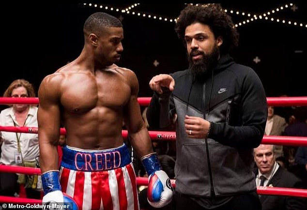 Juggling act: Michael will not only star and take over directing duties from Steven Caple Jr. (R, pictured in 2018), but he'll pull triple duty executive producing the ninth Rocky installment