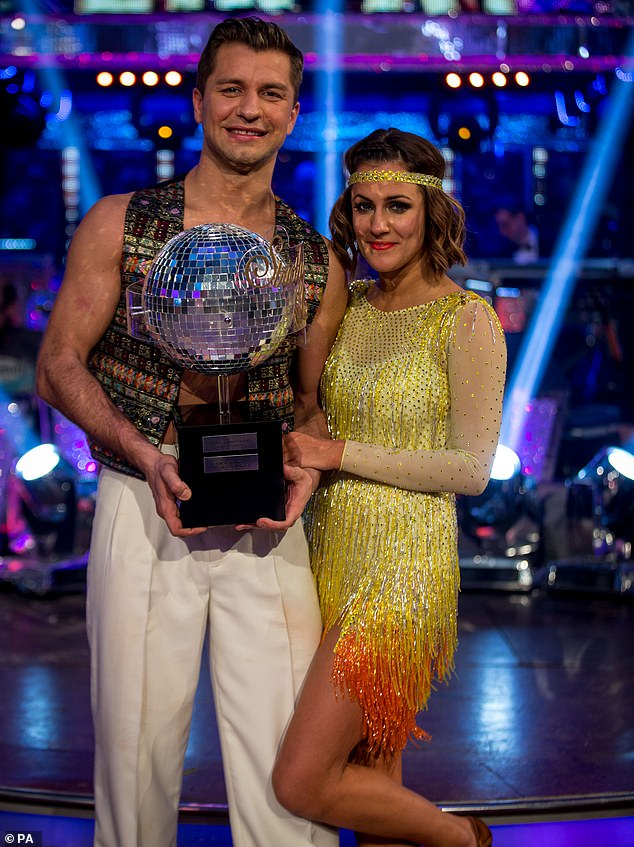Former champions: Pasha said of Caroline, Winning Strictly is such an incredible feeling... and for Caroline it was proof all her hard work paid off and she took home the Glitterball trophy'