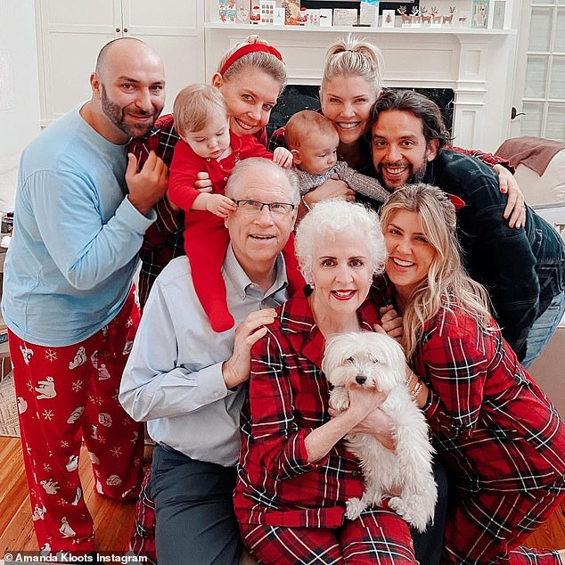 'I love this picture of my family': Amanda beamed with joy as she struck a pose with her family
