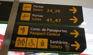 Gates, passport control and toilets signs are seen at Lisbon's airport, Portugal.