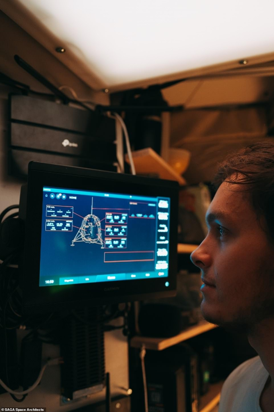Karl-Johan Sørensen sits in front of Lunark's control panel. Although the team had an advanced software system to monitor the habitat, they were offline the whole time and had no smartphones