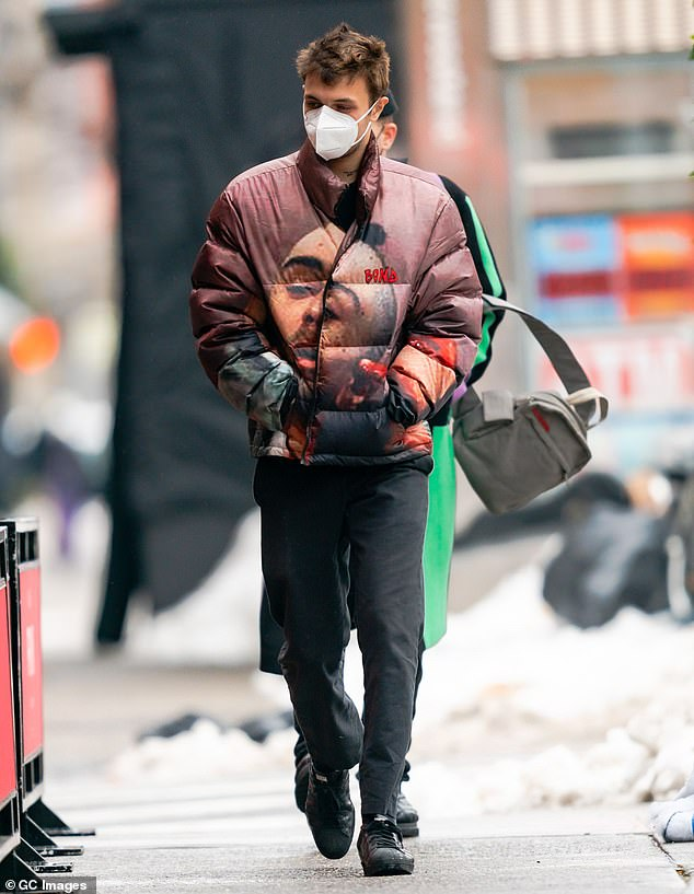 Mask up:To date, the United States has recorded 18million cases and 330,000 deaths, while global deaths are slowly nearing two million, and NYC - where he has been residing - has been one of the hardest hit; pictured December 20, 2020