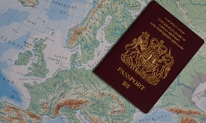 Photo of a United Kingdom of Great Britain and Northern Ireland passport against a map of Europe.