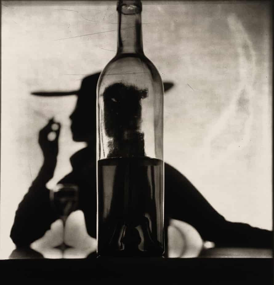 Irving Penn - Girl Behind Bottle, New York, 1949