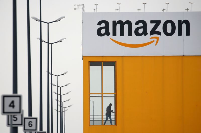 © Reuters. FILE PHOTO: The logo of Amazon is seen at the company logistics center in Lauwin-Planque