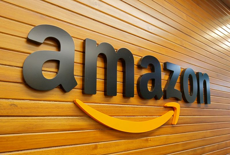 © Reuters. FILE PHOTO: The logo of Amazon is pictured inside the company's office in Bengaluru