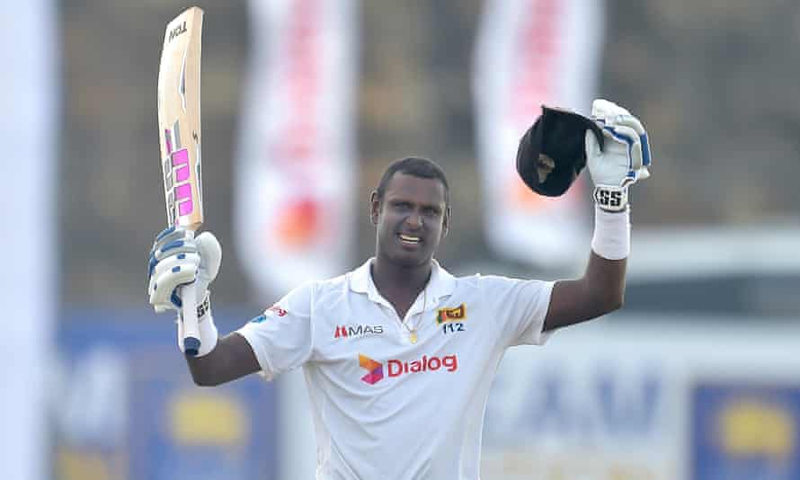 Angelo Mathews celebrates after scoring his 11th test hundred during the second test between Sri Lanka and England.