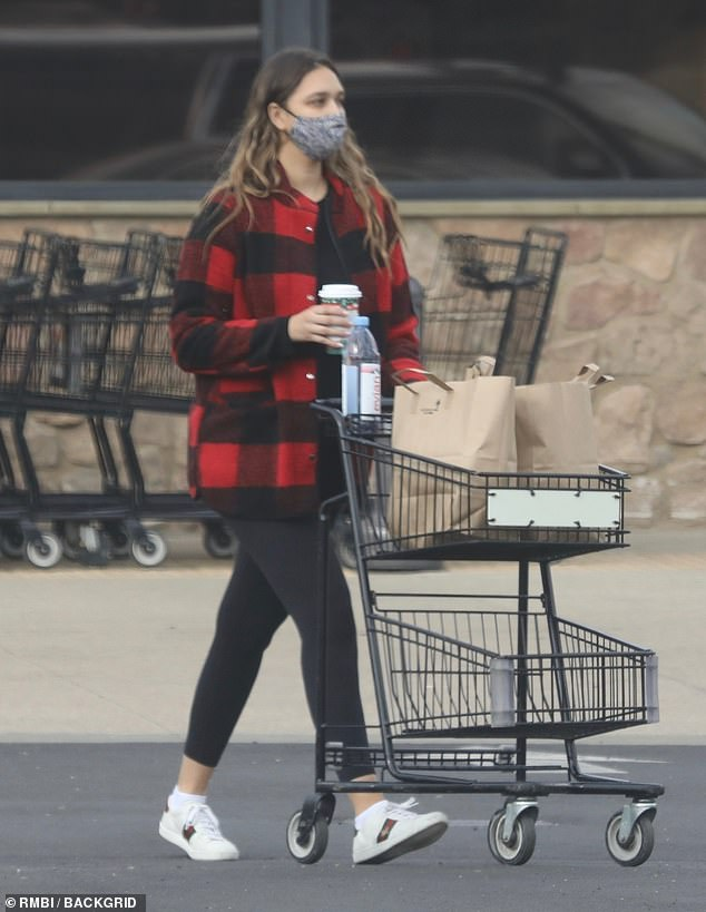 Errand run:April Love Geary was spotted stocking up on groceries for her family on Sunday afternoon near their home in Malibu