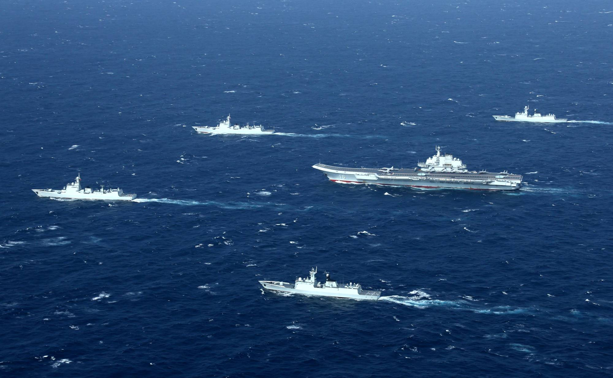 China's Liaoning aircraft carrier with accompanying vessels conducts a drill in the disputed South China Sea in December 2016. | REUTERS