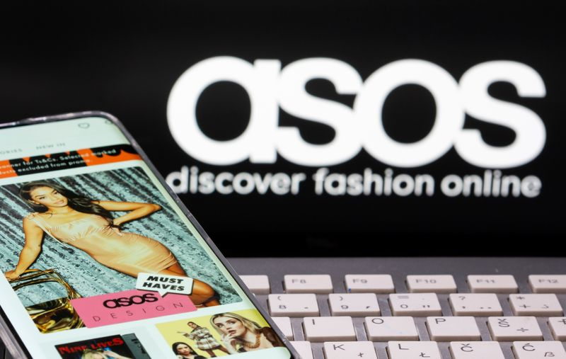 © Reuters. Smartphone with an ASOS app and a keyboard are seen in front of a displayed ASOS logo in this illustration picture