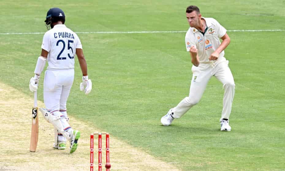Josh Hazlewood celebrates taking the wicket of Cheteshwar Pujara.