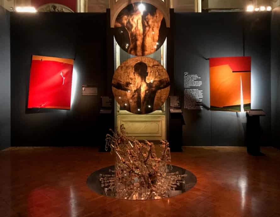 Works by Andy Lianes Bulto, centre, and Saliba Doueihy, left and right, in the exhibition Wounded Art