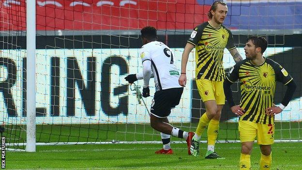 Jamal Lowe points at the camera inside Ben Foster's net after scoring Swansea's equaliser against Watford