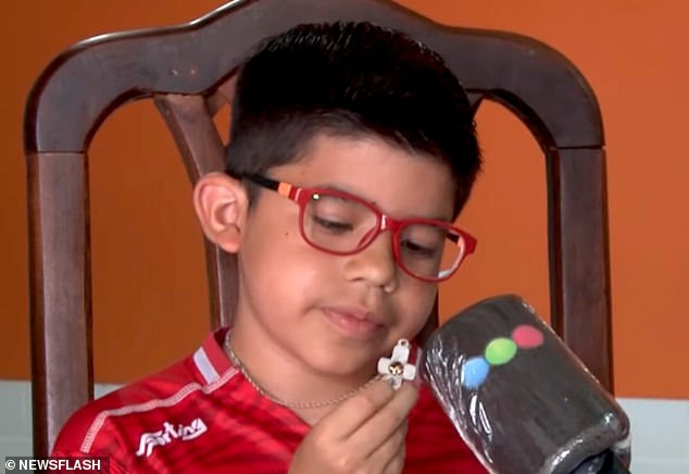A boy has cheated death after his crucifix necklace stopped a stray bullet from penetrating his chest in Argentina