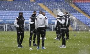 Snow falls at Bolton Wanderers