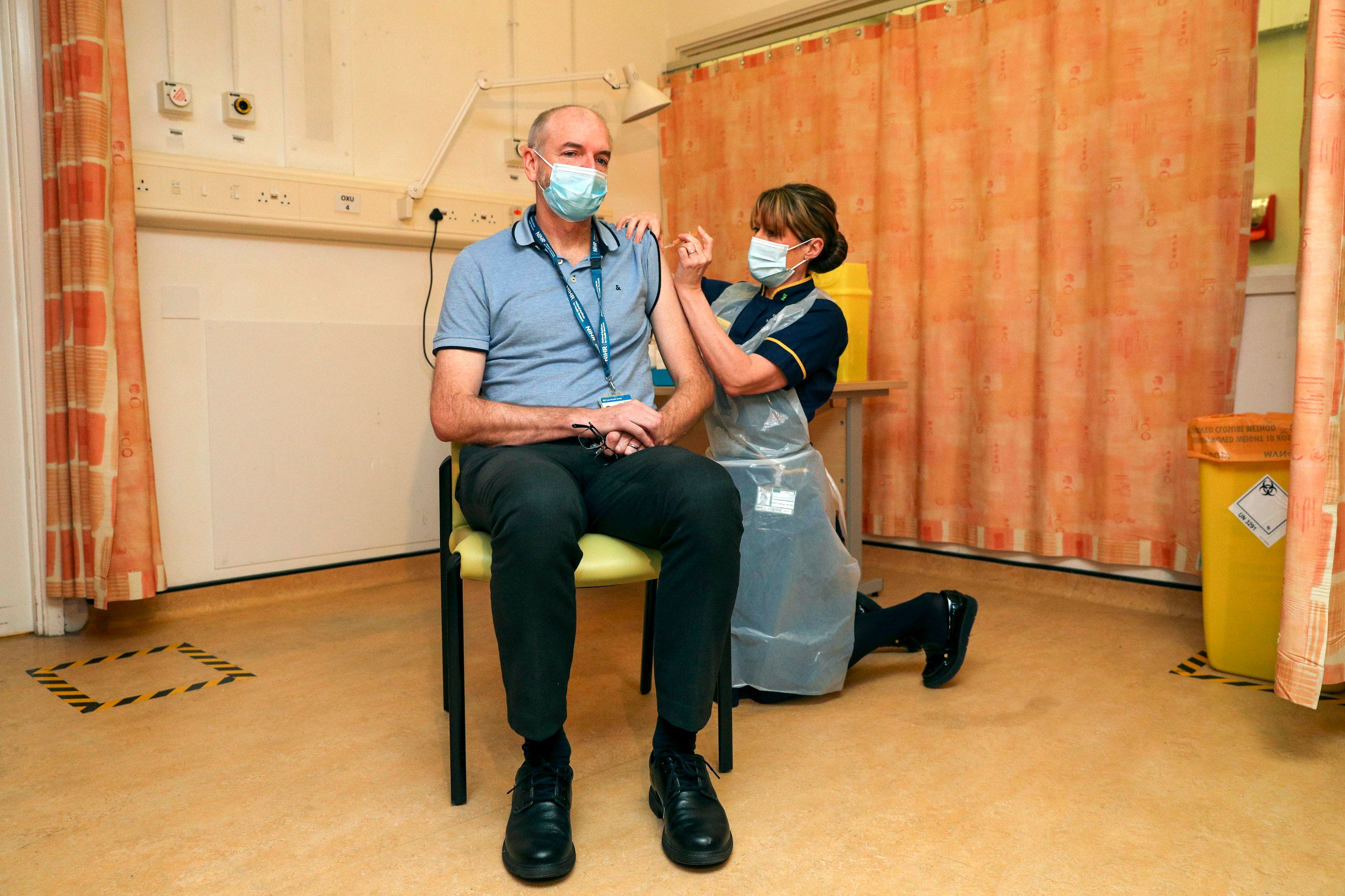 <p>Professor Andrew Pollard, Director of the Oxford Vaccine Group, and a professor of paediatric infection and immunity receives the Oxford vaccine</p>
