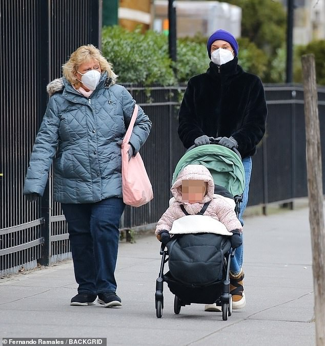 Family outing: Diane Kruger took a stroll with her momMaria-Theresa Heidkrüger and her daughter in New York on Monday, looking stylish in a zipped up black jacket and blue beanie