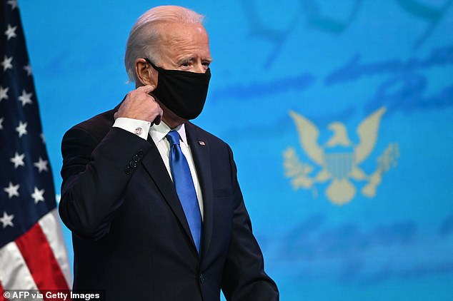 Physicians from Brigham and Women's Hospital and Harvard and the founder of a YouTube educational channel wrote a letter to the Biden administration. Pictured: Biden removes his facemask as he arrives to deliver remarks on the Electoral College certification at the Queen Theatre in Wilmington, Delaware, December 2020